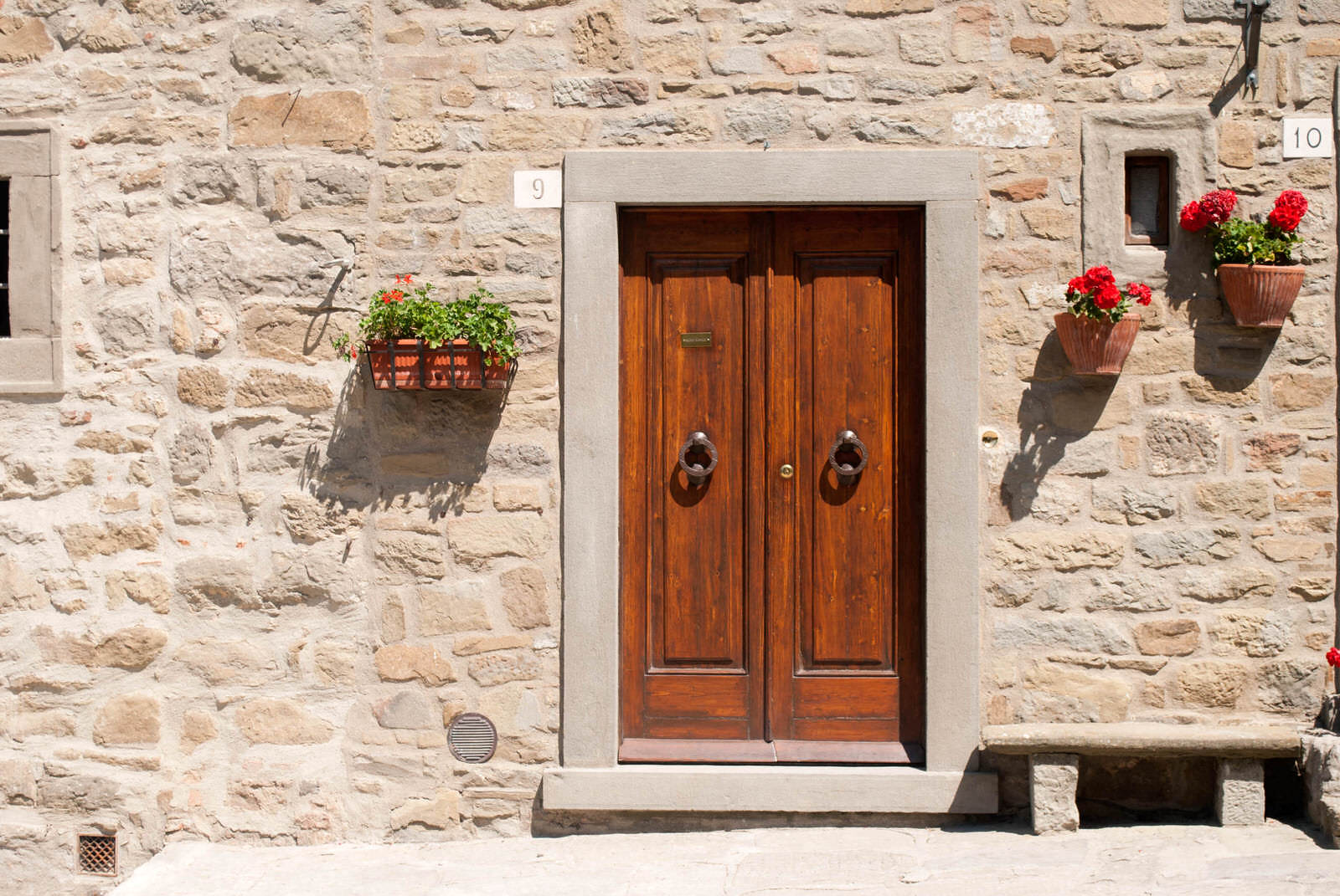 Doorway to a Cortona home decorated with flowers